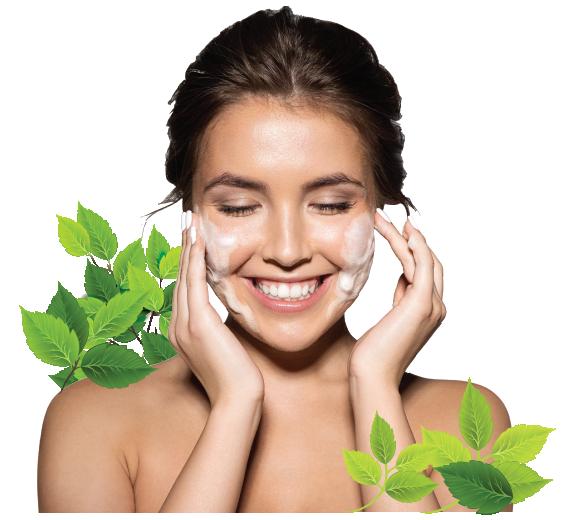smiling woman applying cream on cheecks