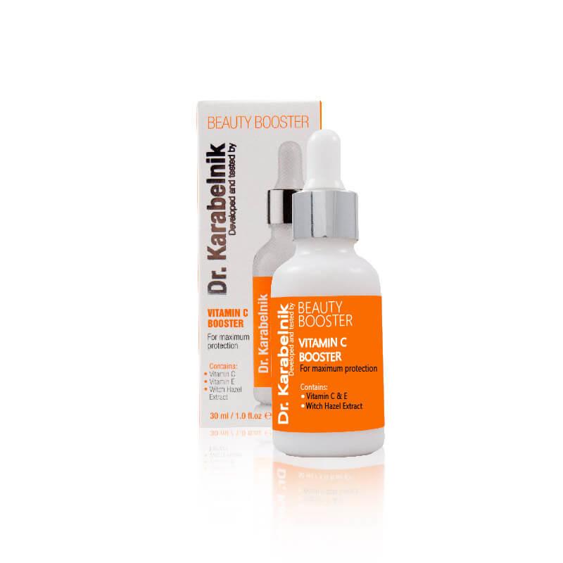 White and orange packaging and bottle of cosmetics on white background